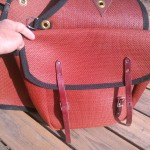 Leather straps, metal buckles, brass grommets
